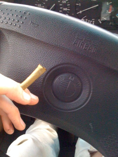 mini blunt in the bmw:) half was too densely rolled and i had to bowl it but whateveerrr