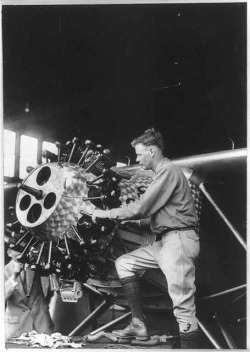 "Charles Lindbergh working on engine of ""The Spirit of St. Louis,"" 1927 (Library of Congress)."