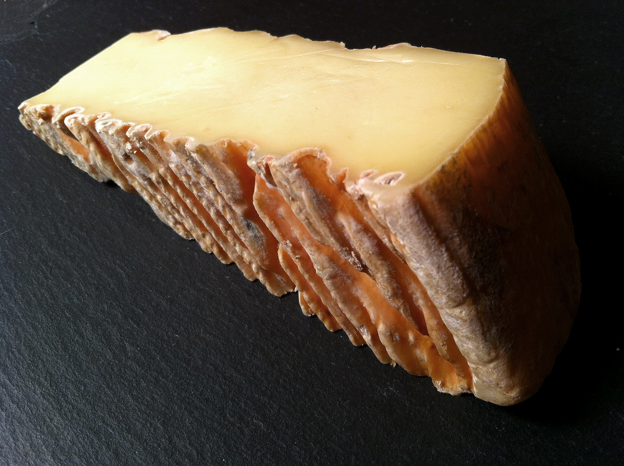 Tobasi, from Cricket Creek Farm in Williamstown, MA, is a Taleggio-style raw cow's milk washed rind cheese made in the heart of the rolling Berkshire hills. In 2002 Dick and Jude Sabot, hearing that the Cricket Creek Farm — the largest dairy farm in the Williamstown area — was up for sale, decided to purchase it, to protect it from encroaching development and preserve it as a working farm. A visit to Shelburne Farms in Vermont led to the decision to continue dairying and develop a cheesemaking program as well, while also converting the herd to pastured and grass-fed and moving the farm towards sustainable methods. Sadly, Dick Sabot passed away unexpectedly in 2005, but Jude and their son, Topher, have continued to develop the farm and expand the cheese offerings. Their Maggie's Round, an Italian-Toma-inspired cheese, won First Place at the 2011 American Cheese Society Competition in Montreal, and they have expanded the makes to include a bloomy-rind, Berkshire Bloom and the Tobasi (as well as fresh cheeses).