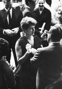 Rita Hayworth surrounded by reporters, c. 1960.