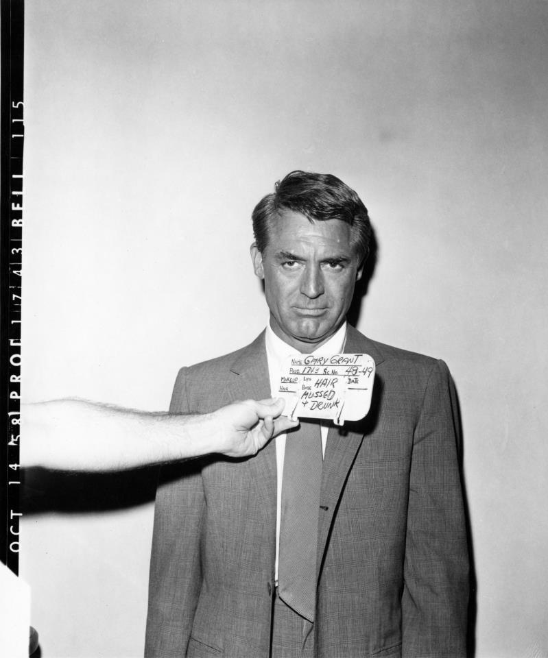 Cary Grant on the set of North by Northwest as as Roger O. Thornhill, clearly the worse for a bourbon and a sports car.