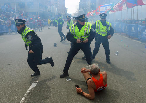 Police react in aftermath of explosion at Boston Marathon. Photo Credit: John Tlumacki
