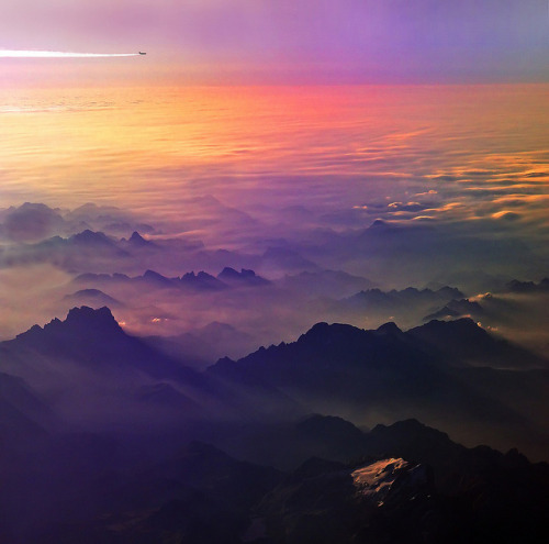 illusionwanderer:  Flying to somewhere by Antonio Zarli  Flying over Alps at sunrise