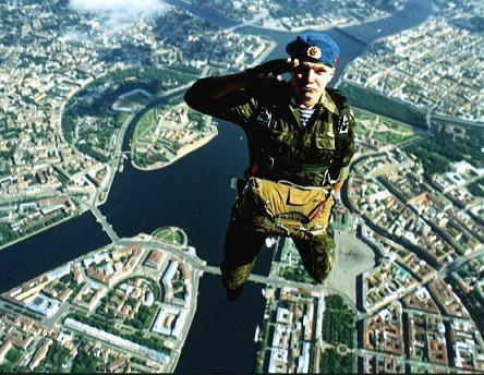 gunrunnerhell:  Salute A member of the Russian Airborne during a jump over Moscow. August 2nd is VDV (Airborne) Day. Current and former airborne members gather and celebrate but it usually gets out of hand.