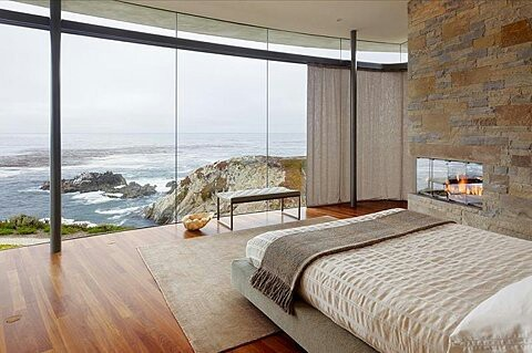 A bedroom with an incredible ocean view