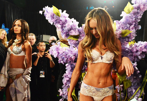 Joan Smalls and Candice Swanepoel.Backstage|VSFS: 2012.Outfits: Silver Screen Angels and Angels in Bloom.