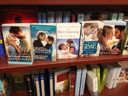 thatfunnyblog:  White People Almost Kissing, a book by Nicholas Sparks Funny Stuff you like?  a copy & paste writer. damn at least get a little creative with the covers. dude just plagerized himself.