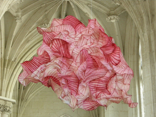 "showslow:  Peter Gentenaar's Ethereal Paper Sculptures Float in the Air Like Jellyfish Peter Gentenaar's art was born out of the limitations of what he could (or couldn't) create with store-bought paper. So with the help of the Royal Dutch Paper Factory, he built his own paper factory and devised a custom beater that processes and mills long-fiber paper pulp into the material you see in his artwork. He saw the potential that wet paper had when reinforced with very fine bambooribs, and he learned to form the material into anything his imagination would allow. Gentenaar describes the process: ""By beating my pulp very long, an extraordinary play of forces occurs during the drying processes of my paper sculpture. The paper will shrink considerably, up to 40%, and the forces associated with this put the non-shrinking bamboo framework under stress. The tension between the two materials transforms itself into a form reminiscent of a slowly curling autumn leaf."""