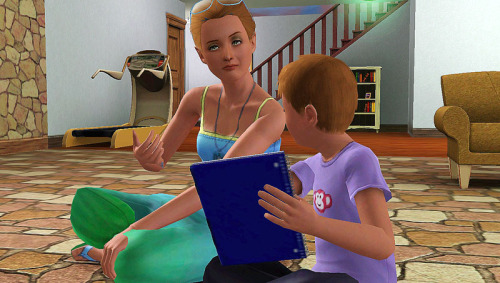 Mommy, Ariana, helps her son, Braden doing his homework.