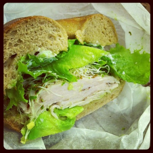healthybuddha:  Delish turkey sandwich on a whole wheat bagel, with avocado, lettuce, and sprouts. Yum.