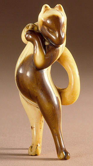japaneseaesthetics:  'Dancing Fox' netsuke. 18th century, Japan. Ivory with dark staining and sumi ink. LACMA (Raymond and Frances Bushell Collection)