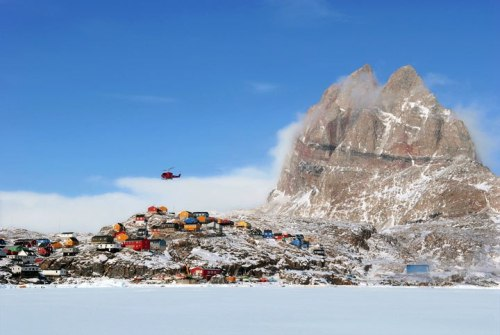 "Going to the Dogs in Greenland | Uummannaq (""Heart-Shaped"") Mountain, 350 miles north of the Arctic Circle, towers over the eponymous town, which can be reached only in good weather—and only by helicopter."