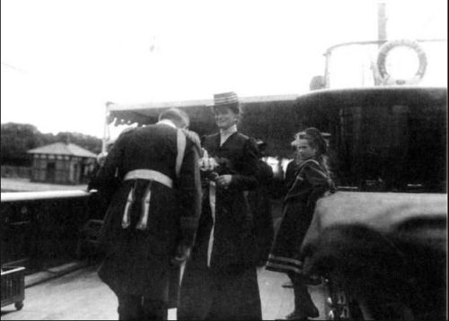Empress Alexandra and Grand Duchess Tatiana greeting an official aboard the Standart: 1908.