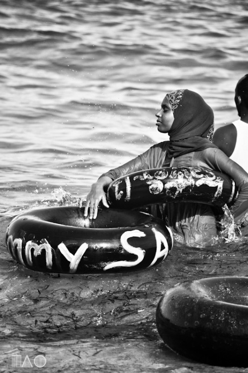 'Veiled and Tubed'. Shot on Jomo Kenyatta Public Beach Mombasa. For more images from this series check out: http://www.trueafricanoriginal.com/2013/03/veiled-and-tubed.html#.UV8v9o6s4UU