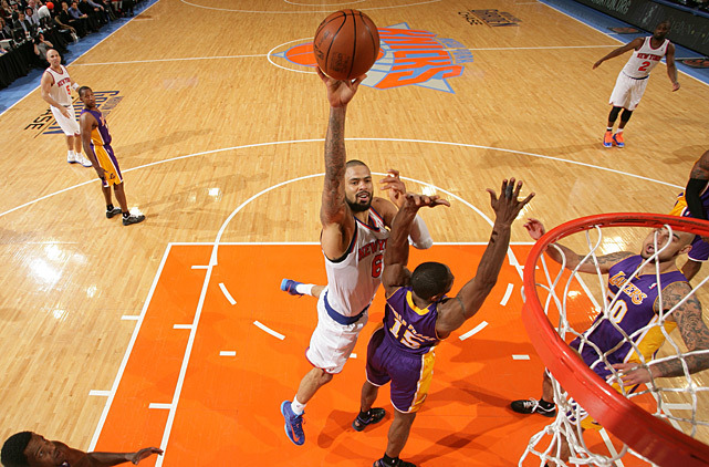 Tyson Chandler shoots over Metta World Peace during Thursday's Knicks-Lakers game. Chandler scored 18 points and grabbed four rebounds as New York ran away with a 116-107 victory. (Nathaniel S. Butler/NBAE via Getty Images) FORRESTER: Lakers searching for answers after latest loss