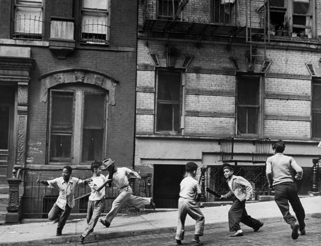 life:  Young boys with play a street game in Spanish Harlem in January 1947. See more photos here. (Ralph Morse—Time & Life Pictures/Getty Images)