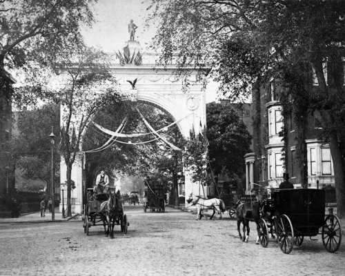 Original Washington Square Arch, 1890. View North along Fifth Avenue with and horse drawn carriages.