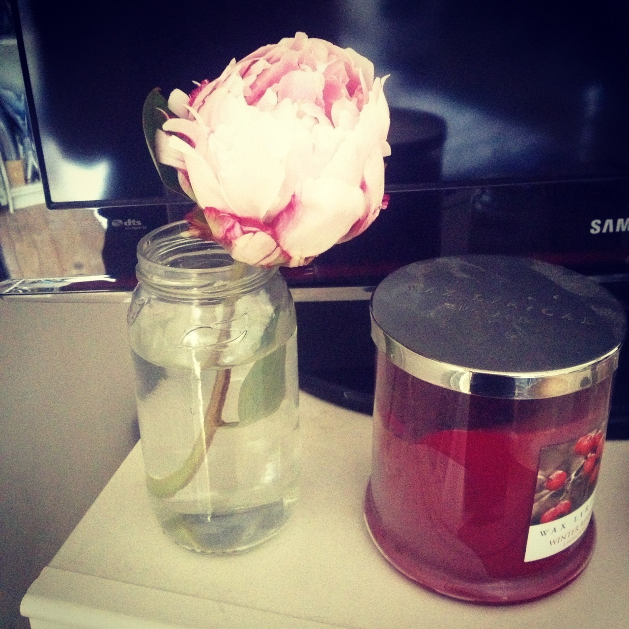 I put one of the left over flowers in a jam jar on my chest of drawers ☺