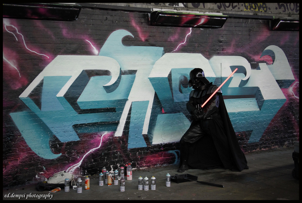 Daily Graffiti Darth Vader flexing his flavor in front of a GLOS piece spotted in London by Ed Dempsi. Daily Graffiti archives Join our Geek Graffiti Flickr group
