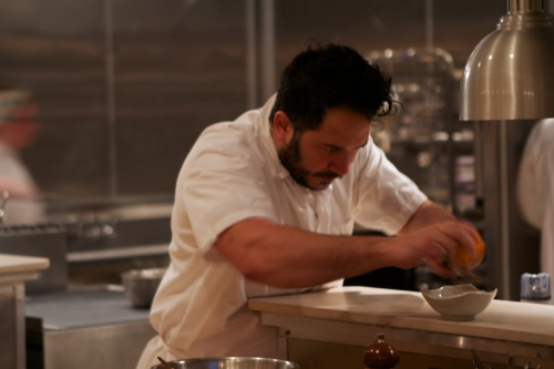 "ryansutton:  I photograph Carlo Mirarchi grating zest over his nduja raviolo at Blanca in Brooklyn. The spicy, porky course is a study in luxury via perfection and portion control; you only get one bite, baby. If the fancy, French-y black truffle explosion at Chicago's Alinea (also one bite) had a humble Italian analogue, it would be this. Those who wish to make reservations for the $180 tasting can do so on Tuesday, 2 January 2013, starting at 9:00am, by calling 646.703.2715.   Just a friendly BAD DEAL reminder that Blanca in Bushwick will be taking reservations for the month of January tomorrow morning. We reblog the above shot from our original photo tumblr, ""Ryan Sutton is 3.0."" We hope you follow, despite the moderately obnoxious name!"