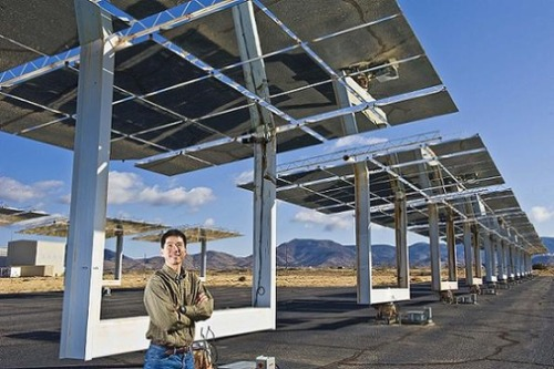 This photograph features Clifford Ho, an engineer at Sandia National Laboratories, who stands below Sandia's solar heliostat field. The Chinese Institute of Engineers-USA selected Ho as its Asian American Engineer of the Year Award in 2010.