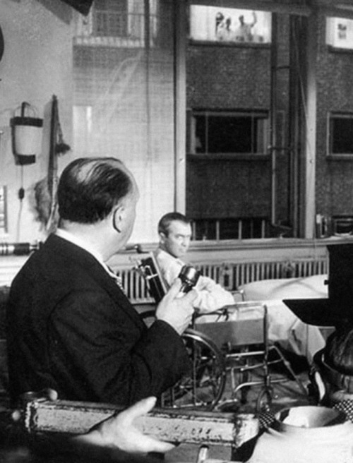 waltdisneywithblood:  Alfred Hitchcock and James Stewart on the set of Rear Window (1954). Hitchcock used a microphone to give instructions to the actors in the other apartments. (Via)