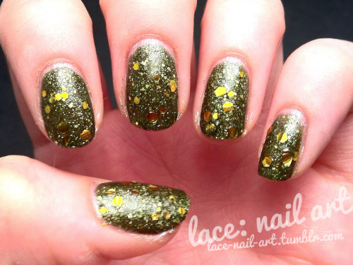 here's a glitter bomb for you. this is china glaze it's alive and kleancolor tiara gold. it's alive is the coolest polish ever. an I like that this almost has a military look to it. lovin it.
