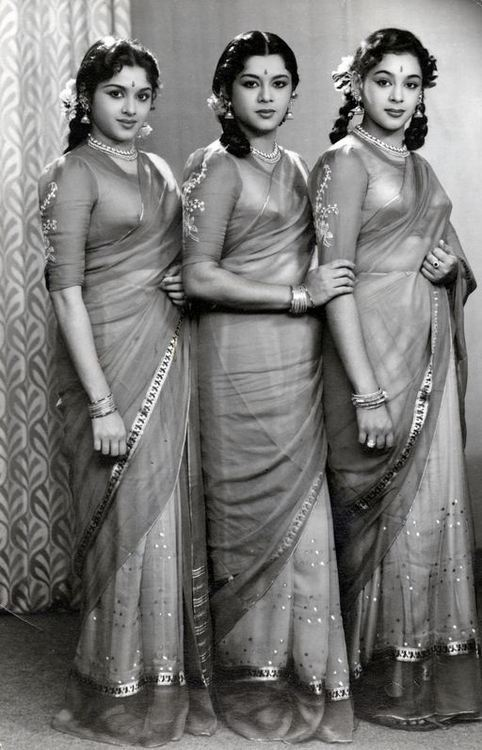 vintagesareeblouse:  The Travancore Sisters were a famous dancing trio and one of them, Padmini, was a major star in South Indian cinema and also acted in Hindi films.  Betsy Woodman's family lived next door to the sisters and her blog is full of fascinating details about both expat life in India in the 50s (her mother also learnt dance while in India) and the everyday lives of the sisters. The picture here is from her family album and appears thanks to her.  I love the matched nature of the outfits, the little embroidery details on the blouses. And that they carry off the doubled up plaits. And am wondering if the brassiere (really an inner bodice) is handmade as was quite common back then.   Used by permission of the Woodman family - source here.  PS: The sisters dancing in an early film.