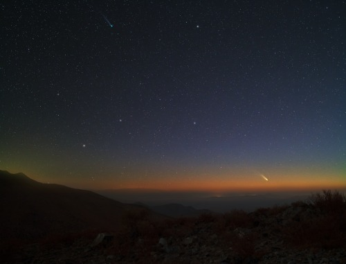 Comets Lemmon and PanSTARRS Peaking  Two impressive comets will both reach their peak brightness during the next two weeks. Taking advantage of a rare imaging opportunity, both of these comets were captured in the sky together last week over the Atacama desert in South America. Comet C/2012 F6 (Lemmon), visible on the upper left of the above image, is sporting a long tail dominated by glowing green ions. Comet C/2011 L4 (PanSTARRS), visible near the horizon on the lower right, is showing a bright tail dominated by dust reflecting sunlight. The tails of both comets point approximately toward the recently set Sun. Comet Lemmon will be just barely visible to the unaided eye before sunset in southern skies for the next week, and then best viewed with binoculars as it fades and moves slowly north. Comet PanSTARRS, however, will remain visible in southern skies for only a few more days, after which it will remain bright enough to be locatable with the unaided eye as it moves into northern skies. To find the giant melting snowball PanSTARRS, sky enthusiasts should look toward the western horizon just after sunset. Deep sky observers are also monitoring the brightening of Comet C/2012 S1 (ISON), which may become one of the brightest objects in the entire night sky toward the end of 2013. 2+  Two comets appear in the sky at the same time. Unfortunately, it will be rainy and cloudy for the next few days, I really hope I still have a chance for a glimpse on Friday.