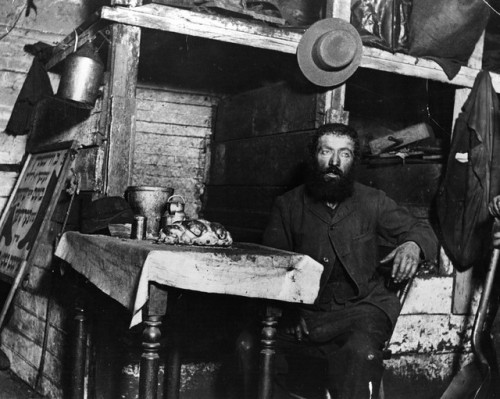 ofskfe: A Jewish cobbler ready for Sabbath Eve in a coal cellar in New York, where he is living with his family, 1887. This photograph is one of a series taken of New York's slums, using the newly invented technique of flashlight photography. (Photo by Jacob A Riis/Getty Images)