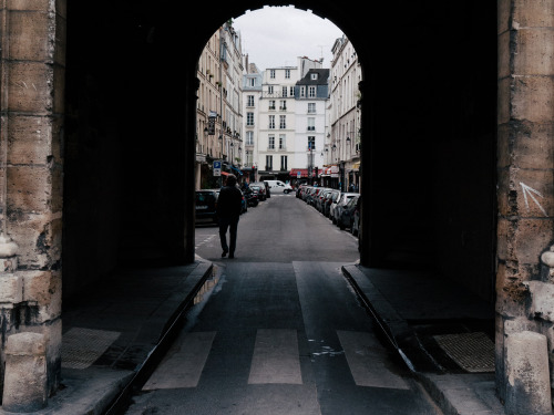 Looking out. Place de Vosges, Paris.