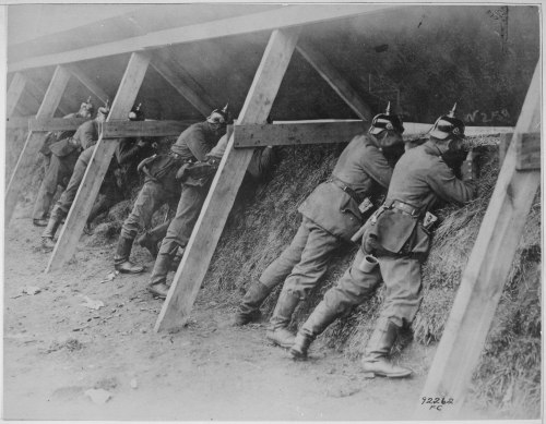 "georgy-konstantinovich-zhukov:  ""Germans in their well protected trenches on the Belgian frontier showing the men in the act of aiming at their enemy."" National Archives"