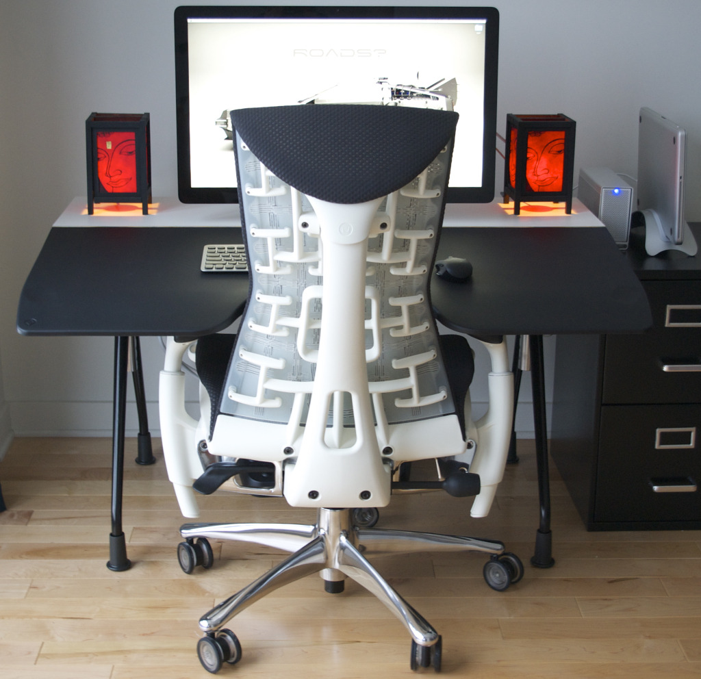 Great setup with the coveted Herman Miller Embody chair.  Nice touch with the lamps too.