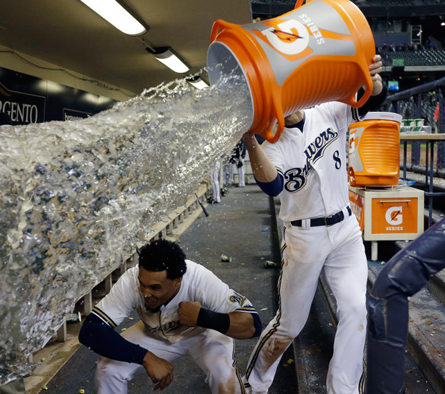 Carlos Gomez ducks out of the way as teammate Ryan Braun tries to drench him with water after a Brewers'Giants game last Thursday. Milwaukee won 4-3. (Morry Gash/AP) GALLERY: Did You See That?