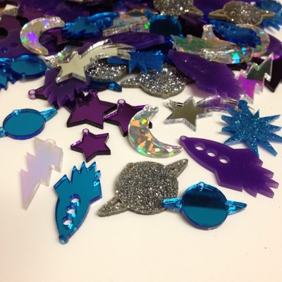 Laser cutting some new galaxy themed charms I designed!