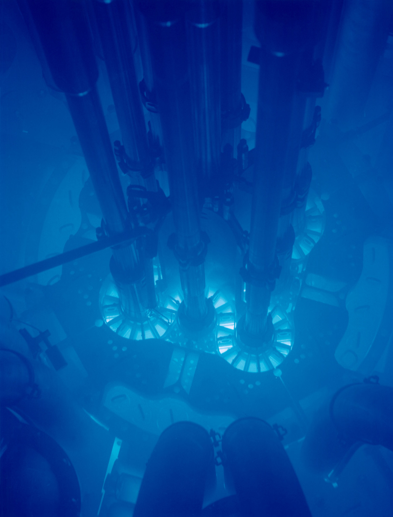 Cherenkov radiation glowing in the core of the Advanced Test Reactor (ATR), a research reactor at the Idaho National Laboratory, Idaho, USA. Cherenkov radiation is electromagnetic radiation emitted when a charged particle (such as an electron) passes through a dielectric medium at a speed greater than the phase velocity of light in that medium. The charged particles polarize the molecules of that medium, which then turn back rapidly to their ground state, emitting radiation in the process. The characteristic blue glow of nuclear reactors is due to Cherenkov radiation.