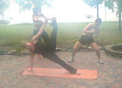 Yoga @ Houghton Lake, MI. My sisters in the back interupting my FOCUS!  :)