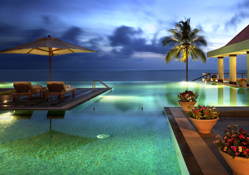 Infinity pool of the moment: The Leela Kovalam Beach Kerala Sandwiched between sea and mountains, The Leela  is located near Kerala on the southern tip of India.This area gets a relatively high rainfall which makes the landscape the greenest in India.