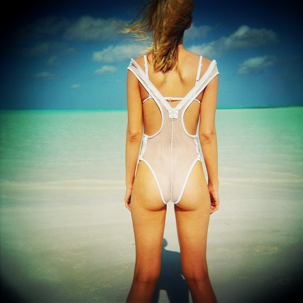 "@seesyou  in the Bahamas - outtake from our spring 12 shoot, taken with my #holga JP is wearing the ""Christie"" mesh suit with the ""Cheryl"" top..:) all available @ www.minimale-animale.com xx (at WWW.MINIMALE-ANIMALE.COM)"
