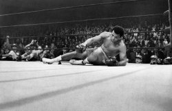 "March 8, 1971: Joe Frazier knocked down Muhammad Ali in the 15th round of the ""Fight of the Century.""  Viewers of the remarkable match in 350 theaters and arenas in the United States, Canada and 35 other countries saw the climactic punch 16 times via  instant replay. Photo: Larry C. Morris/The New York Times"
