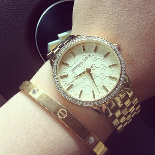 varsitypink:  Gold hardware for my first day back at work 💕 #michaelkors #cartier #goldflow