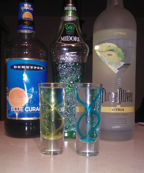 T-Virus and Antidote (Resident Evil shots) Ingredients:T-Virus-2 oz Blue Curacao1/4 tsp Agar powder1 1/2 oz Citrus vodka T-Virus Antidote-2 oz Midori1/4 tsp Agar powder1 1/2 oz Citrus vodka Tools-Small panFood syringe Silicon tubing that fits the syringe (1 ft. minimum)Glass of ice waterTall shot glasses Directions: This recipe is for those who like the previous T-Virus and Antidote shots, but want to wow your guests with something a bit more complicated. In a pan, bring the blue curacao or Midori to almost a boil. Remove it from the heat and mix in the agar powder with a spoon or spatula. Suck the liquid into the syringe and inject it into the tubing. Submerge the tubing into the glass of ice water and wait around 5 minutes for it to solidify. After about 5 minutes, remove the tubing from the water. To remove the newly solidified gel from the tube, fill your syringe with air and use the air to push the gel out. Cut the gel strings into the appropriate length for your shot glass. Carefully wrap the gel around the inside of your shot glass and slowly pour in citrus vodka. Serve, infect, and heal.  Drink created and photographed by FIReWAtEr. For more detailed directions and photos of the process, head over to his blog.