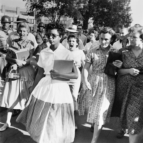 ramonageraldinequimby:  Elizabeth Eckford ignores the hostile screams and stares of adults and fellow students at Little Rock's Central High School in September 1957.