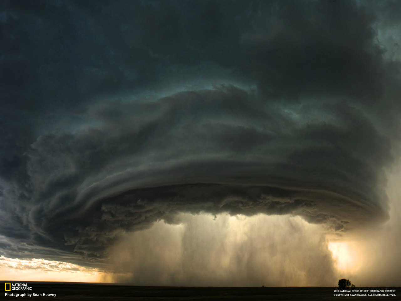 littlelimpstiff14u2:  A supercell thunderstorm rolls across the Montana prairie at sunsetCredit by Sean Heavey