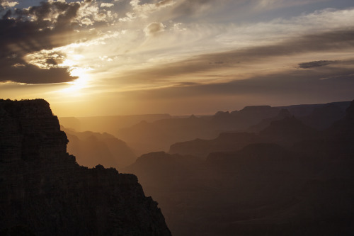 SUNRISE TO SUNSET AT GRAND CANYON - ARIZONA National Park Week - April 20-28, 2013 There is no better place to accidentally find yourself during the National Park Service's free week than the second most visited park, Grand Canyon. With nearly 5 million visitors a year, Grand Canyon is as good for its people watching as it is for the view itself.  You can go a long time without hearing a single word of English, but easily make out that everyone has the same mix of marvel and disbelief as they walk up the trail to Mather Point and catch their first glimpse of the South Rim.  The dark pines of the Kaibob National Forest conceal the Grand Canyon of the Colorado till the rim is reached. There, spread out for seemingly endless miles, is an ocean of color. From misty blue depths rise gigantic islands of crimson sandstone. Their undulating bands of red and purple grow softer in color and outline towards the horizon, where a single firm stroke seems to separate the rosy depths from the sky above. Its immensity is awful; the boldness of its contours overwhelming; its immobility terrifying. —Arizona, The Grand Canyon State: A State Guide (WPA, 1940)  Guide Note: National Park Week occurs each spring. * * * At-Large Guide to the West James Orndorf was born in Minnesota, but knew at a very young age that the future lay out west. He is currently photographing and illustrating outside of Durango, Colorado. You can see what he's up to atinlandwest.tumblr.com and roughshelter.com.