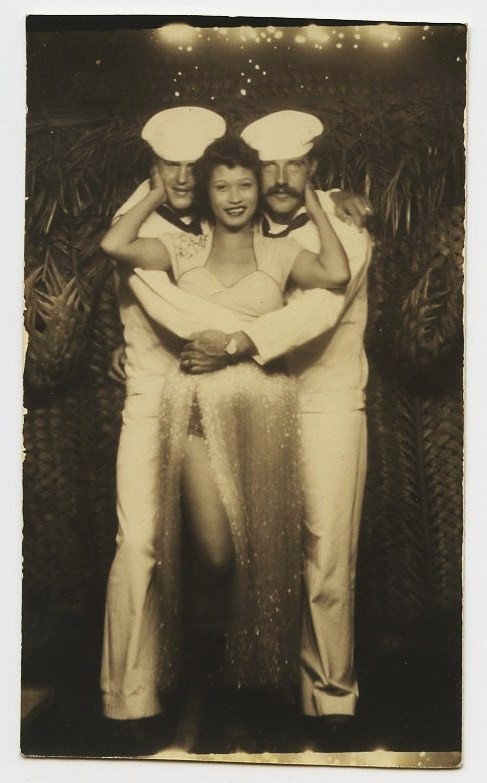 adventures-of-the-blackgang:  WW2 1940's TIKI HUT Arcade Photo American Sailors & Hawaiian Hula Girl on ebay  I would like to recreate this, mustache and all