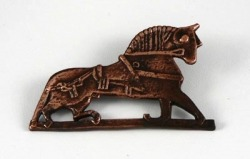 Reproduction of horse brooch from clay fragments found in a bronzesmith workshop at Ribe, Denmark, 9th century