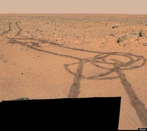"thedailywhat:  This Isn't Photoshopped of the Day: NASA Mars Rovers Accidentally Drew This This may be the most expensive penis graffiti in the history of humanity. NASA's twin exploration rovers Spirit and Opportunity accidentally drew what appears to be a large phallus during their 10km-plus exploration on the surface of Mars. The discovery was first made yesterday by Redditor radioactive_toy in a post submitted to the /r/pics subreddit, which quickly reached the frontpage and temporarily brought down the NASA web server as a result of the ""Reddit Effect."""