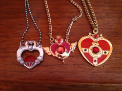 silvermoon424:  All of my Sailor Moon necklaces! <3 Buy the Garnet Orb necklace Buy the Crisis Moon Compact necklace Buy the Cosmic Heart Compact necklace