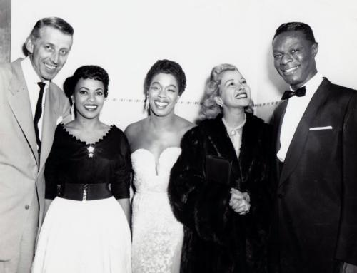 "This photo of Nat ""King"" Cole, Sarah Vaughan and Thelma Carpenter Georgia Carr comes to VBG courtesy of the lovely blonde woman in the picture, Monica Lewis, who had a remarkable decades long career as a jazz singer. Ms. Lewis is 90 years old today and just as stunning! She is joined by Sarah Vaughan and Nat King Cole of course, along with Stan Kenton, a progressive jazz bandleader that she was dating at the time. The occasion was a gathering of top musicians in Chicago sponsored by BILLBOARD magazine. I wish I knew the name of the beautiful lady standing in between Ms. Vaughan and Mr. Kenton (she is not Mr. Cole's wife, Maria Cole) so if you do know, tell me her name in the comment section!*** *** Thanks to Derrick Lucas for contacting Mr. Cole's former manager, Dick LaPalm, but clearly Mr. LaPalm was mistaken. And thank you Toni Callender for your comment and giving me the opportunity to correct the original post - and the excuse to share the lovely Georgia Carr with VBG fans."